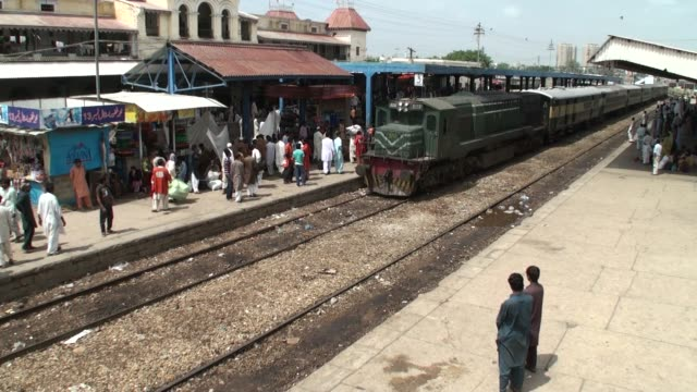pakistani passengers stand on a platform of karachi railway station karachi cantonment railway station one of the principal railway stations in... - sindh pakistan stock videos and b-roll footage