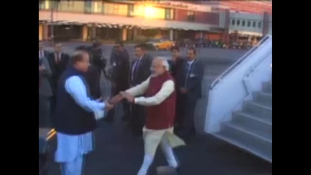 Pakistani Prime Minister Nawaz Sharif warmly welcoming his Indian counterpart Narendra Modi at the airport in Lahore Pakistan on December 25 2015