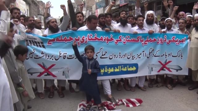 pakistani protesters chanted anti american slogans friday following a funeral prayer in absentia for taliban chief mullah akhtar mansour who was... - placard stock videos & royalty-free footage