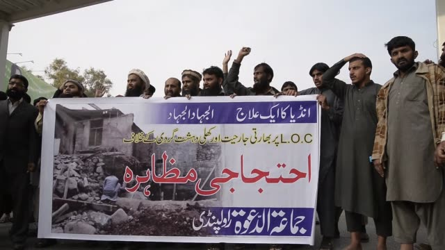 pakistani religious group jamaatuddawa protest indian agression on pakistani kashmir after jumaa prayer in islamabad pakistan on november 25 2016 - punjab india stock videos and b-roll footage