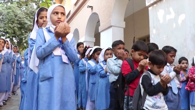 Pakistani school children pray for the victim of PIA plane crash in Abbottabad district in northwest Khyber Pakhtunkhwa province in Karachi Pakistan...