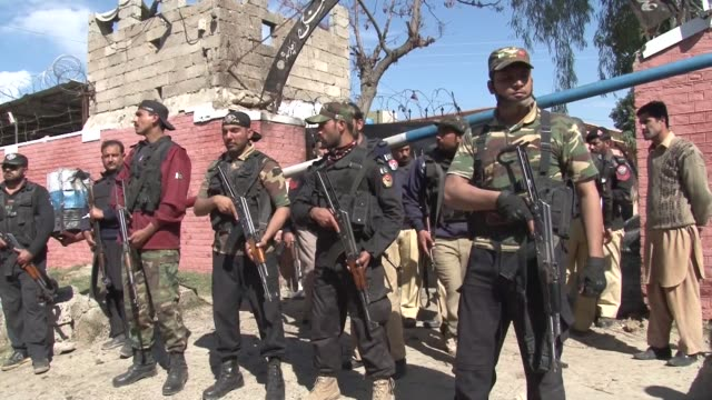 Pakistani security officials inspect and secure the scene after three suicide bomb attackers targeted a court building in Tangi area of Charsadda...