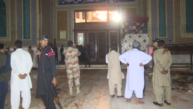pakistani security officials inspect the shrine of lal shahbaz qalandar after a suicide bomber struck inside the main hall of the shrine in sehwan... - sindh pakistan stock videos and b-roll footage