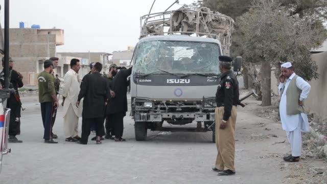 pakistani security officials inspect the site of a roadside blast targeting a police vehicle in quetta pakistan on september 13 2016 at least two... - terrorism stock videos & royalty-free footage