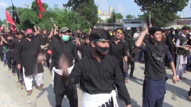 pakistani shiite muslim worshippers selfflagellate in islamabad to perform an annual mourning ritual on the 9th day of the islamic month of muharram... - ashura muharram stock videos & royalty-free footage