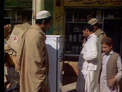pakistani shoppers examine a refrigerator in the market place - crime or recreational drug or prison or legal trial stock videos & royalty-free footage