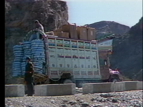 pakistani smugglers deliver goods into the mountains of afghanistan - crime or recreational drug or prison or legal trial stock videos & royalty-free footage