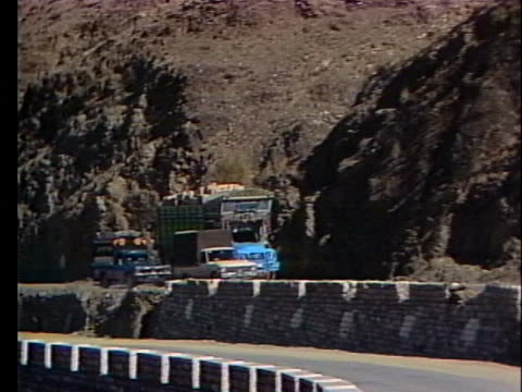 a pakistani smugglers truck drives along khyber pass in afghanistan - crime or recreational drug or prison or legal trial stock videos & royalty-free footage