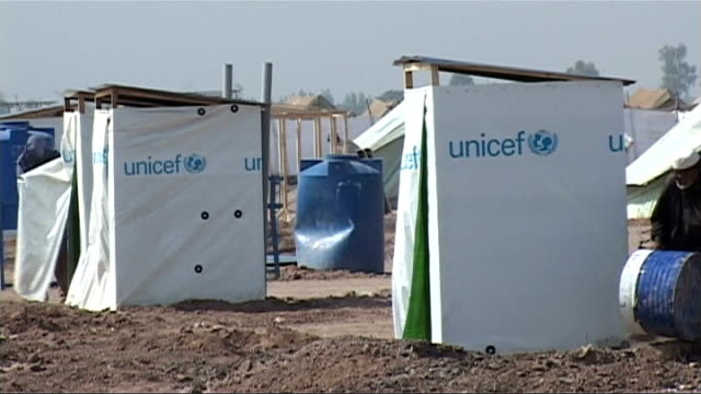 pakistani troops on patrol in afghan border region unicef toilets and fuel tanks in refugee camp - unicef stock videos & royalty-free footage
