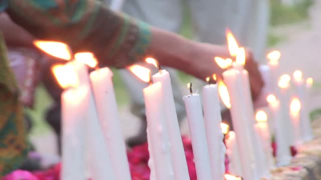 pakistanis hold a small candlelight vigil organised by a minority forum group for the victims of the sri lanka easter blasts which claimed nearly 300... - sri lanka stock videos & royalty-free footage
