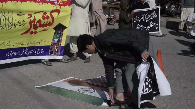 pakistanis protest the latest incident in indian side of kashmir by chanting slogans and trampling and burning indian and us flags after friday... - pakistan stock videos and b-roll footage