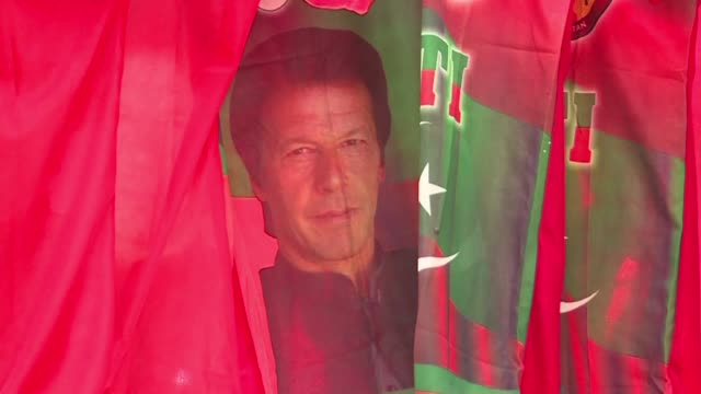 pakistanis react after early unofficial election results favour former cricket champion imran khan with ballot tallying still underway as major... - rigging stock videos & royalty-free footage