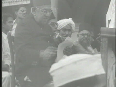 pakistanis riding truck handing out fliers to others on streets male handing out fliers from truck another reading arabic writing - 1948 stock videos & royalty-free footage