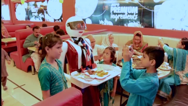 pakistan's first robot waitresses are serving up smiles for customers at an upscale pizza restaurant in the ancient city of multan better known for... - south asia stock videos & royalty-free footage