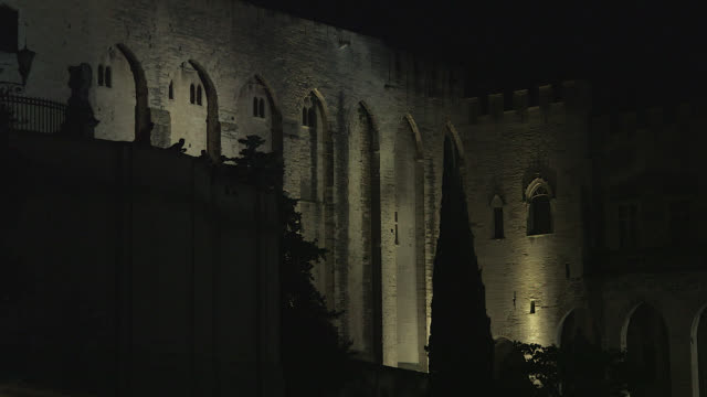 palace of the popes in avignon, at night, tight shot - gothic stock videos & royalty-free footage