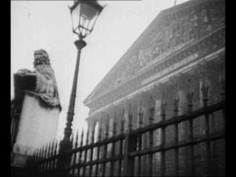 palace of versailles in far background with other buildings in front / tiltup shot ext palais bourbon with statue of jeanbaptiste colbert at left... - french national assembly stock-videos und b-roll-filmmaterial