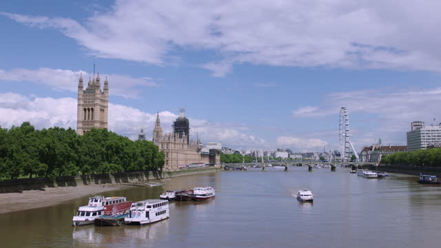 palace of westminster and victoria tower alongside the river thames / london, england - cumulus stock videos & royalty-free footage
