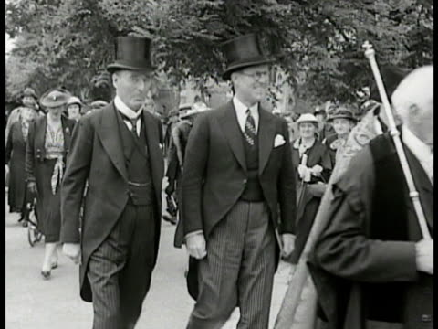 palace of westminster. british man in suit w/ u.s. ambassador joseph p. kennedy walking in court of st. james. int vs kennedy at desk talking paper.... - 1938 stock videos & royalty-free footage