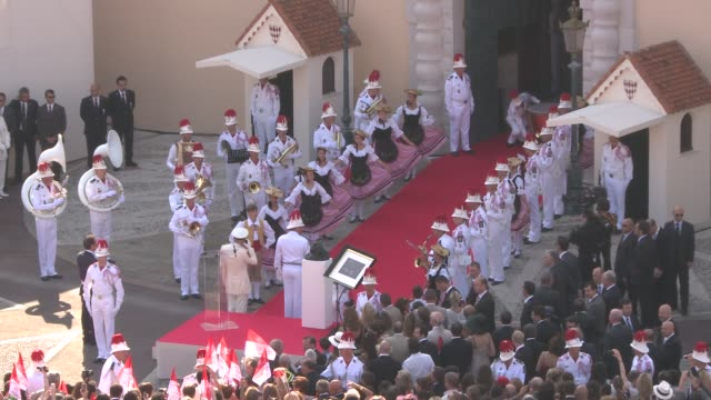 palace staff in traditional outfit at the monaco royal wedding first appearance of married couple at monaco - royal palace monaco stock videos and b-roll footage
