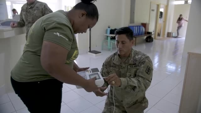 palau's ministry of health work along side a us army medical outreach team in peleliu palau as part of exercise palau which includes several... - micronesia stock videos & royalty-free footage