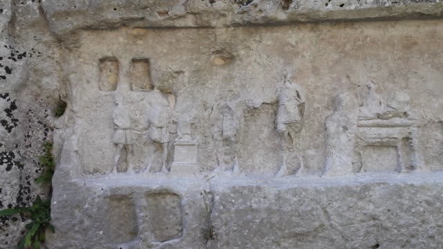 palazzolo acreide, the latomia dell'intagliatella, a bas-relief carved in the rock with scenes of sacrifices - bas relief stock videos & royalty-free footage