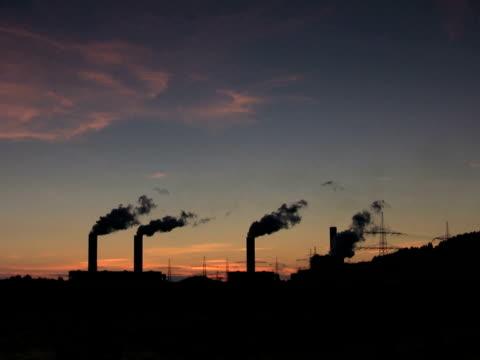 stockvideo's en b-roll-footage met pal:climate crisis - mens gemaakte bouwwerken