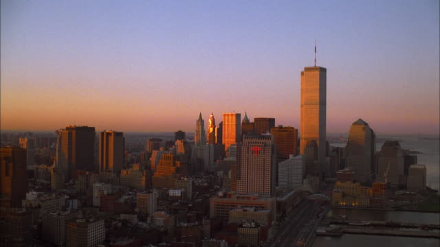 A pale blue and pink sky glows above downtown Manhattan. Available in HD.
