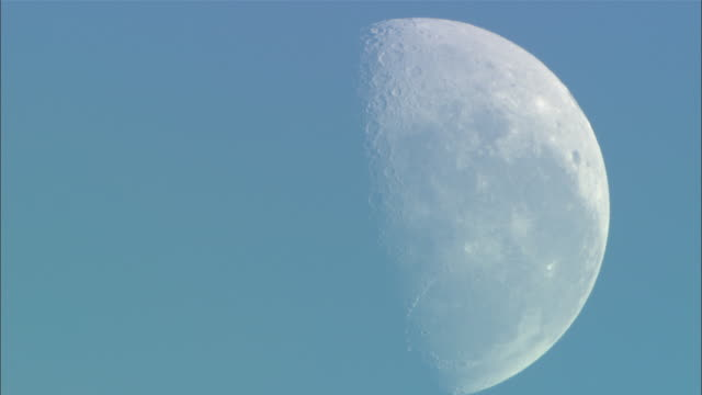 a pale moon glows in a blue sky. - western cape province stock videos & royalty-free footage