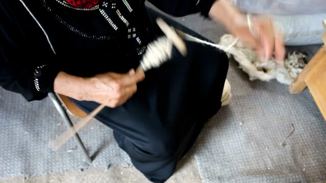 Palestine, Kasarat Bedouin camp around Jerusalem, hands of Bedouin woman spinning wool