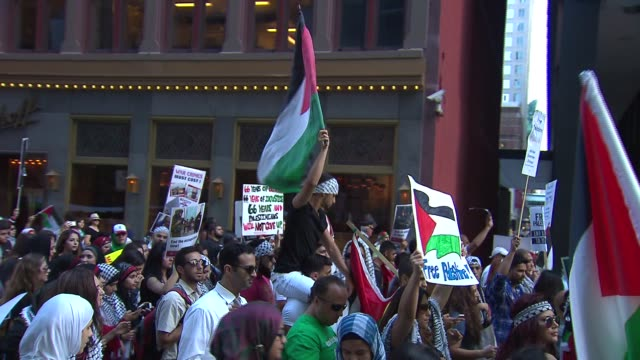 wgn palestine supporters rallied in front of the israeli consulate then marched to federal plaza to demand an end to the ongoing violent attacks on... - palestinian flag stock videos & royalty-free footage