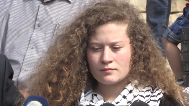 palestinian ahed tamimi speaks to media next to her father bassam and mother nariman during a press conference in nabi saleh village near the west... - media occupation stock videos & royalty-free footage