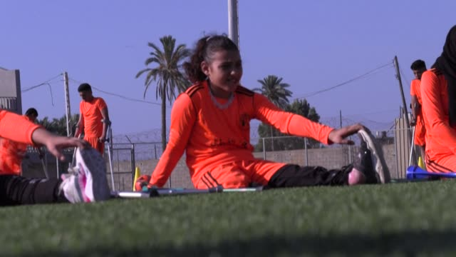 palestinian amputee football players participate in a training session organised by the international committee of the red cross in gaza strip's deir... - football strip stock videos & royalty-free footage