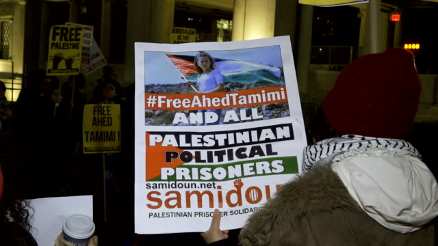 palestinian and israeli activist and supporters protest the arrest of ahed tamimi a 16yearold palestinian girl tamimi was arrested by israeli... - palestine girl stock videos and b-roll footage