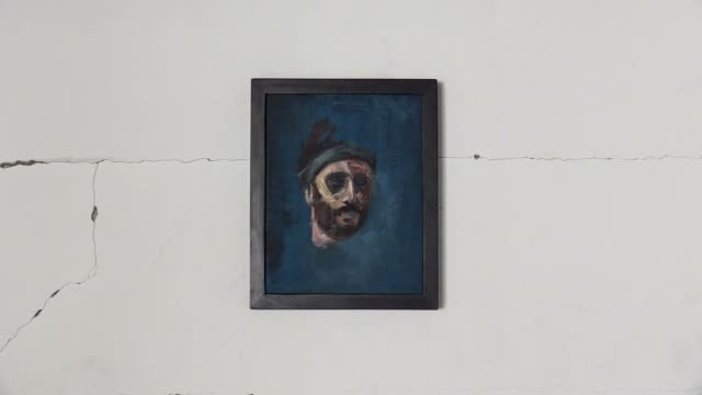 """palestinian artist ali al-jabali's paintings are being displayed at his exhibition named """"dreamers among the rubbles"""" on the walls of buildings,... - rubble stock-videos und b-roll-filmmaterial"""