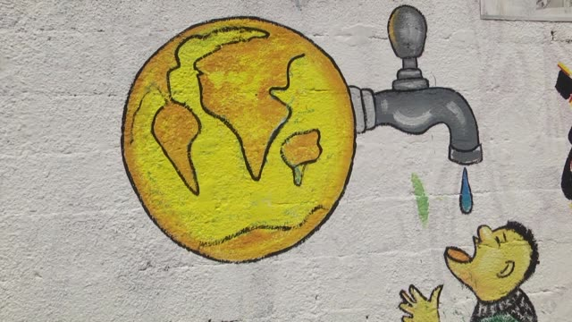 palestinian artists draw murals on 30mlong wall for catching the attention of international community to the water scarcity of gaza in gaza city on... - world water day stock videos and b-roll footage