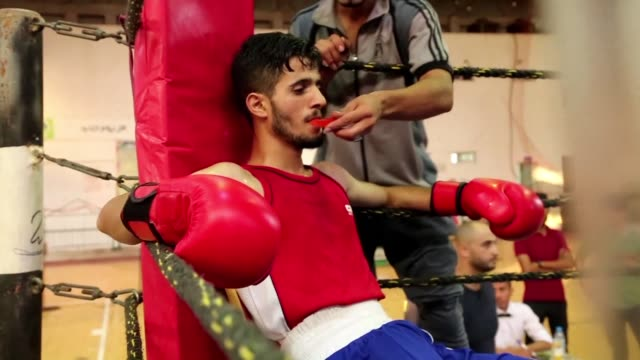 palestinian boxers competed thursday in the first boxing championship in gaza city organized by the palestinian olympic committee - gaza city stock videos & royalty-free footage