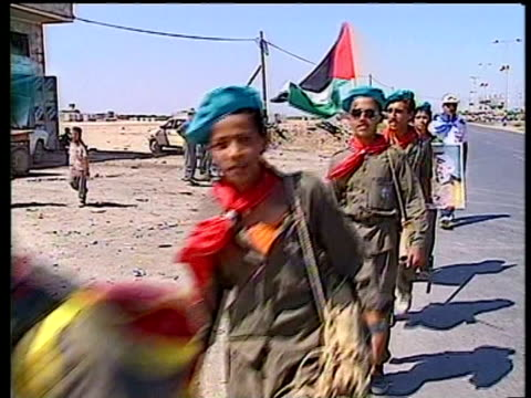 Palestinian boy scouts marching one holding picture of Yasser Arafat Gaza July 1994