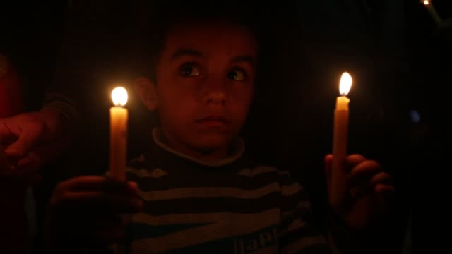 palestinian boys hold candles during a protest against gaza blockade in gaza city on april 17 2017 residents of gaza home to around 18 million people... - exclusive stock videos and b-roll footage