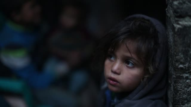 palestinian children are seen at their house as palestinians living in makeshift homes in elzohor neighborhood in the city of khan yunis on the gaza... - gaza strip stock videos & royalty-free footage