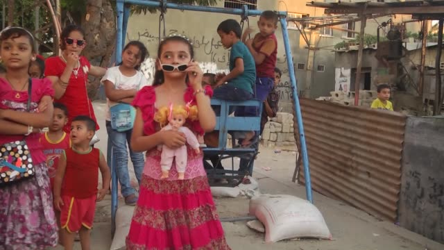 palestinian children enjoy in shujaiyyah neighborhood on july 18 in gaza city at the eid alfitr the threeday festival that follows the fasting month... - eid mubarak stock videos & royalty-free footage
