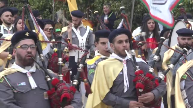 palestinian christian scouts perform at the manger square outside the church of the nativity as people gather for christmas celebrations in the city... - church of the nativity stock videos and b-roll footage
