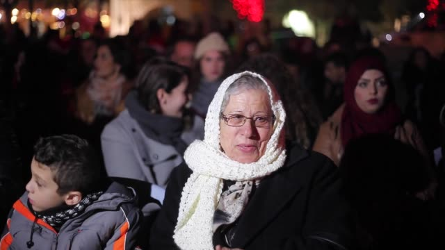 palestinian christians watch fireworks marking the lighting of a christmas tree on december 3 2016 at the manger square near the church of the... - church of the nativity stock videos and b-roll footage