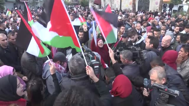 palestinian demonstrators clash with israeli forces during a protest against the us president donald trump's recognition of jerusalem as israel's... - palestinian stock videos & royalty-free footage