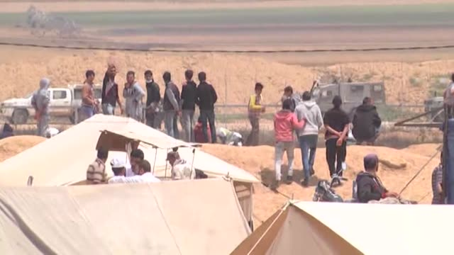 palestinian demonstrators gather for the fifth straight friday of expected mass demonstrations and clashes along the border with israel on april 27... - gaza strip stock videos & royalty-free footage