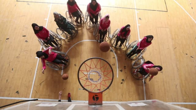 palestinian disabled women compete during a wheelchair basketball training session in gaza city - wheelchair basketball stock videos & royalty-free footage
