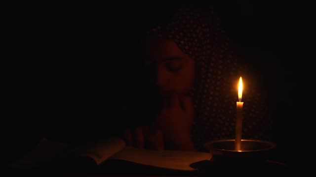 palestinian farah tayyim and her father mahmoud tayyim talk to journalists about the ongoing power cuts in gaza strip on june 27, 2017 at jabalia... - fuel and power generation stock-videos und b-roll-filmmaterial