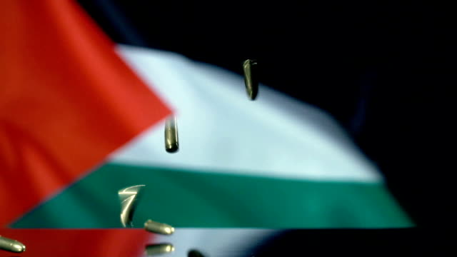 palestinian flag behind bullets falling in slow motion - palestinian flag stock videos & royalty-free footage
