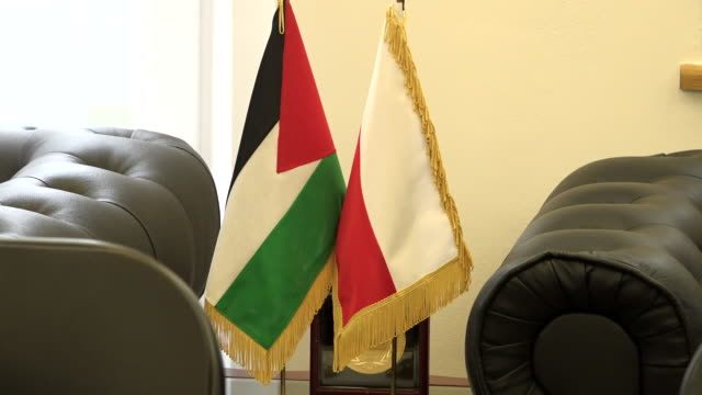 a palestinian flag is seen at the palestinian embassy in warsaw poland on february 4 2020 mister khalifa urged countries to not be indifferent to the... - palestinian flag stock videos & royalty-free footage
