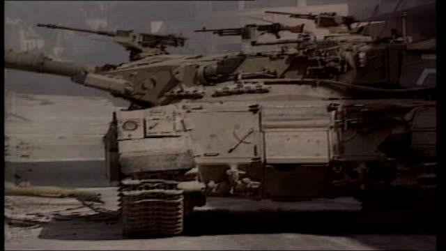 stockvideo's en b-roll-footage met bethlehem israeli tank in street bv tank firing sot gv tank as machine gun firing from side bv tank away along street i/c - israëlisch palestijns conflict