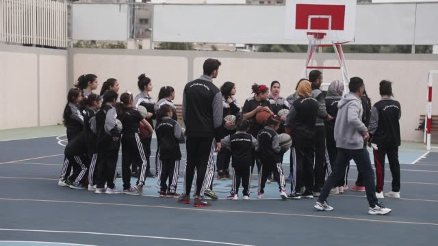palestinian girls take part in a basketball training at the starts academy in gaza city on april 7 2019 the stars academy located in gaza city... - palestine girl stock videos and b-roll footage